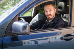 Bearded serious Asian man with keys as a car driver Stock Images