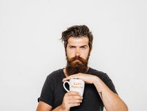 Bearded serious man with cup of coffee or tea Stock Image