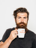 Bearded serious man with cup of coffee or tea Royalty Free Stock Images