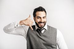 Man Shows Phone Sign stock photography