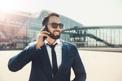 Bearded Businessman Use Phone Before Modern Building royalty free stock photography