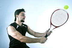 Bearded tennis player. Bearded tennis player on blue background Stock Photo