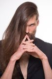 Bearded top model. Portrait of long-haired top model. Man with moustache after fashoin show Royalty Free Stock Photo