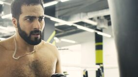 Close up Boxer Training. Bearded topless boxer have punch training, sweat concentrated face, hard working, closeup slowmotion, motivation concept stock video footage