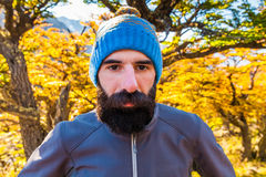 Bearded tourist man in the background of a autumn forest Stock Images
