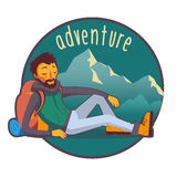 Bearded traveler with backpack in mountains Stock Photography