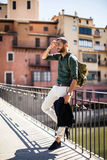 Bearded traveller leaning on parapet and looking away Royalty Free Stock Images