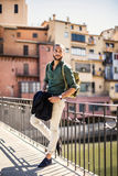 Bearded traveller leaning on parapet and looking away Stock Images