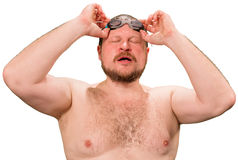 Bearded wet man in goggles Stock Photos