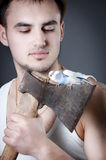 Bearded woodcutter with ax and bird, defender Stock Photography