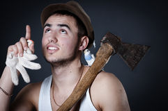 Bearded woodcutter with ax and bird on shoulder Royalty Free Stock Photos