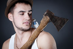Bearded woodcutter with ax and bird on shoulder Royalty Free Stock Photo
