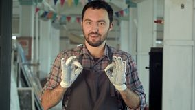 Bearded worker tell something with smile. stock images