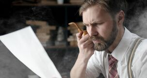 Bearded Writer Reading and Smoking