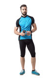 Bearded young adult cyclist with water bottle looking at camera Stock Photos