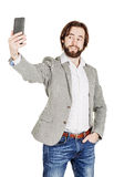 Bearded young business man taking selfie smiling. portrait isolated over white studio background. Handsome bearded young business man taking selfie smiling royalty free stock photography