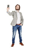 bearded young business man taking selfie smiling. portrait isolated over white studio background. stock photos
