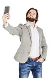 Bearded young business man taking selfie smiling. portrait isolated over white studio background. Handsome bearded young business man taking selfie smiling stock image