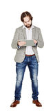 bearded young business man using digital tablet. portrait isolated over white studio background. royalty free stock photos
