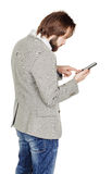 Bearded young business man using smartphone. portrait isolated o stock images