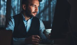 Bearded young businessman working on modern office. Consultant man thinking looking in monitor computer. Manager typing keyboard royalty free stock photo