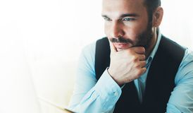 Bearded young businessman working on modern office at night. Consultant man thinking looking in monitor computer. Manager typing royalty free stock photos