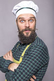 Bearded young chef with surprised expression Royalty Free Stock Photos