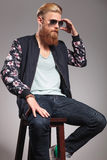 Bearded young man fixes his sunglasses Stock Images