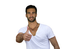 Bearded young man giving a thumbs up gesture Royalty Free Stock Image