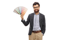 Bearded young man holding a color swatch. Isolated on white background royalty free stock images