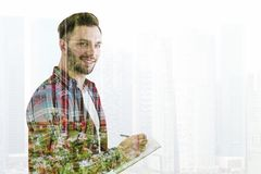 Creative young man in a city Royalty Free Stock Photography