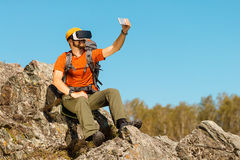 Bearded young man makes selfie in glasses virtual reality outdoors Stock Images
