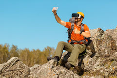 Bearded young man makes selfie in glasses virtual reality outdoors Stock Image