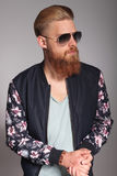 Bearded young man with palms together Stock Photos