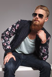 Bearded young man in pensive pose Royalty Free Stock Photo