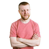 Bearded young man in a pink shirt Stock Photo