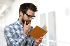 Bearded Young Man Reading Royalty Free Stock Image