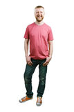 Bearded young man in a T-shirt and jeans Royalty Free Stock Photography
