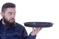 Bearded young man with a tray Stock Images