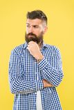 Bearded for your pleasure. Bearded man on yellow background. Bearded hipster touching his unshaven chin. Brutal. Caucasian guy with mustache and beard on stock images