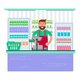 Beardy man working as cashier in shop or supermarket. Hipster re Royalty Free Stock Photography