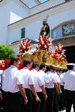 Bearers carrying carnival float, Marbella. Royalty Free Stock Images