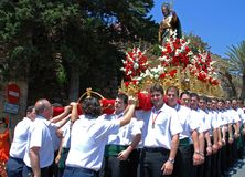 Bearers carrying carnival float, Marbella. Royalty Free Stock Photo