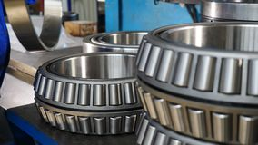 Bearing assembly. Close up. Worker sets part of rolling bearing and turns it. Heavy machinery concept. Part of