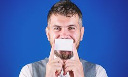 Bearing business information. Happy businessman smiling with bank card. Hipster with credit card. Empty card for your. Contact information. Bearded man holding stock photo