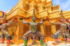 Bearing. The characters in literature Thailand carrying giant golden pagoda in the temple of the Emerald Buddha , also known as the Temple of the Emerald Buddha stock photos