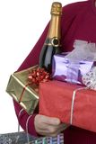 Bearing gifts. Gifts and champagne being held in someone's arms Royalty Free Stock Photography