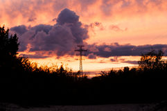 Bearing  power lines on a sunset Royalty Free Stock Photos