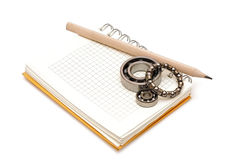 Bearings on the blank notebook. Royalty Free Stock Images
