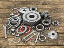 Bearings and gears on wooden background dosok. Stock Photography